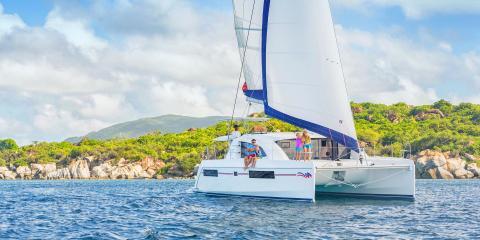 family on sailing catamaran in the BVI