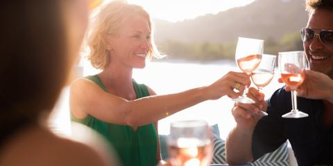 Friends toasting with wine on board their yacht