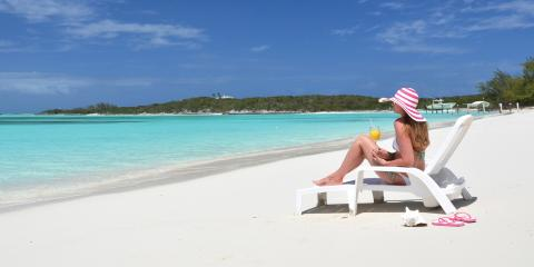 Woman sitting on beach in Exumas