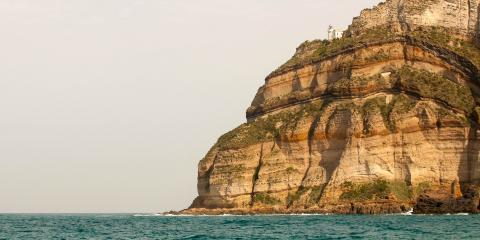 Rocky boulders in sea