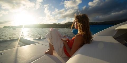 Girl eating cereal on boat at sunrise