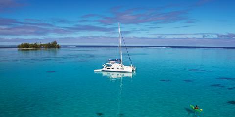 sailing catamaran in Tahiti with kayak