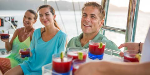 Family drinking on yacht