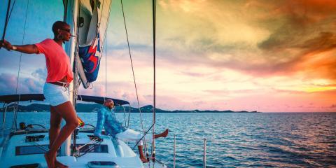 Woman on yacht gazing at sunset