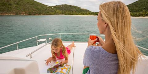 Woman and child on Moorings 434PC sundeck