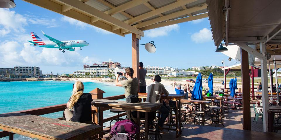 Plane flying over St Maarten Beach